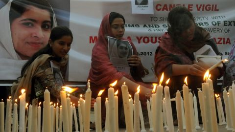 Pakistani human rights activists light candles during a Sunday, October 21, 2012, vigil for Malala Yousufzai in Lahore.