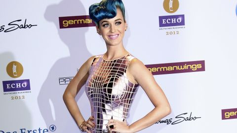 """The singer looks like a sexy disco ball in Paco Rabanne at the 2012 Echo Awards in Berlin. She paired her mirrored frock with embellished Christian Louboutin pumps that spell """"sex."""""""