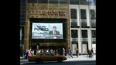 """An advertisement for the television show """"The Apprentice"""" hangs at Trump Tower in 2004. The show launched in January of that year. In January 2008, the show returned as """"Celebrity Apprentice."""""""
