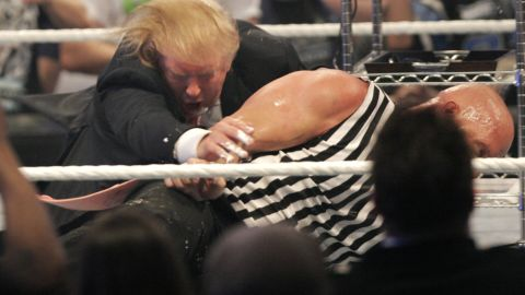 """Trump wrestles with """"Stone Cold"""" Steve Austin at WrestleMania in 2007. Trump has close ties with the WWE and its CEO, Vince McMahon."""
