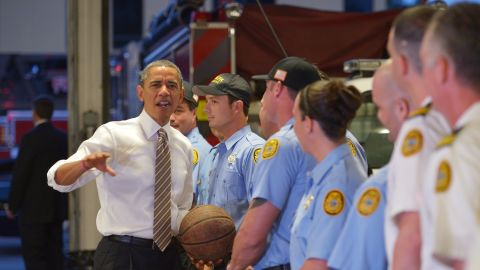 Obama chats with firefighters after dropping off doughnuts for them at a fire station in Tampa, Florida, on Thursday, October 25.