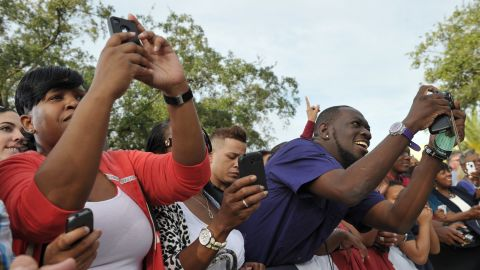 Supporters take photos of Obama during a campaign rally at Ybor City Museum State Park in Tampa on Thursday.