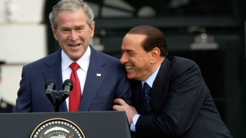 Berlusconi shares a moment with President George W. Bush during an arrival ceremony on the White House South Lawn in October 2008.