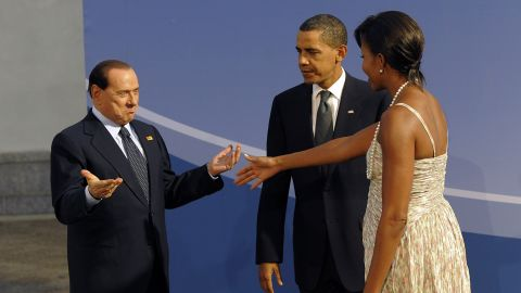 President Barack Obama and first lady Michelle Obama welcome Berlusconi to a G20 dinner in Pittsburgh in September 2009.