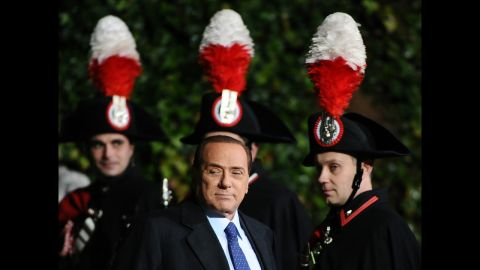Berlusconi passes by Carabinieri guards before a meeting with Russia's President at Villa Madama in February 2011.