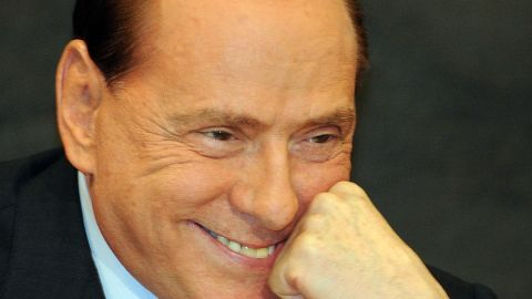 """Berlusconi reacts during the presentation of  Antonio Razzi's book """"My Clean Hands"""" at the Italian Parliament in February 2012."""