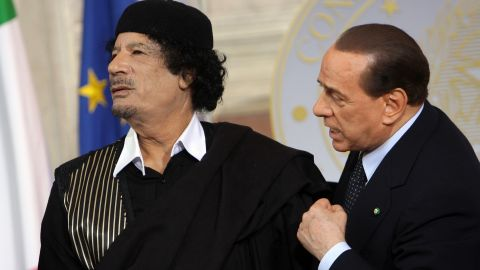 """<a href=""""https://www.cnn.com/2013/09/26/world/africa/moammar-gadhafi-fast-facts/index.html"""">Libya's Moammar Gadhafi </a>attends a meeting with Berlusconi in Rome in June 2009. The Libyan leader was killed in 2011 after being captured by rebel forces in his hometown."""