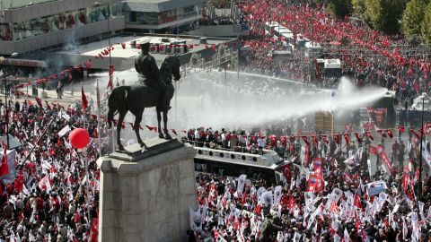 Riot police use tear gas and water canons to disperse the crowd in Ankara, on October 29, 2012.
