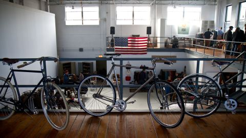 """Handcrafted bicyles from Chicago's <a href=""""http://www.heritagebicycles.com/"""" target=""""_blank"""" target=""""_blank"""">Heritage General Store</a>, a hybrid coffee shop and full-service bike shop, adorn the showroom."""