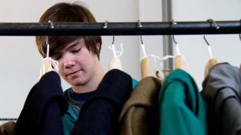 Nick Rokosz, 16, looks through vintage coats and jackets for sale from MidNorth Mercantile at NorthernGRADE pop-up menswear market in Chicago on Saturday, October 27.