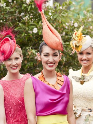"""The 2011 """"Fashions on the Field"""" winner Angela Menz (center) with finalists Alex Foxcroft and Louise Struber."""