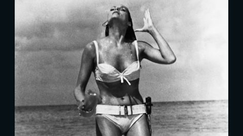 """Ursula Andress played Honey Ryder opposite Sean Connery's James Bond in the 1962 film """"Dr. No."""" Bond first sees Ryder as she emerges from the ocean wearing a white bikini. She asks him, """"What are you doing here? Looking for shells?"""" He replies, """"No. I'm just looking."""""""