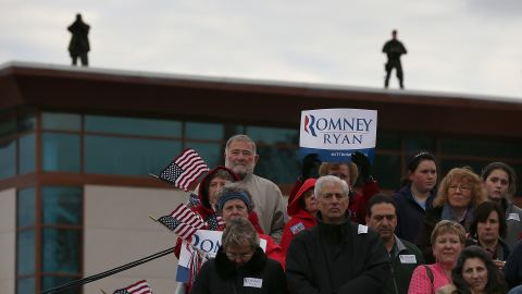 Supporters look on as Romney speaks during a campaign rally in Newington, New Hampshire, on Saturday.