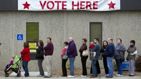 Voters line up outside the Johnson County election office in Olathe, Kansas, in the 2012 November elections.