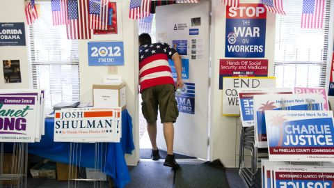 Volunteer David Bowser peeked outside the Pinellas County Democratic Party headquarters in St. Petersburg, Florida.