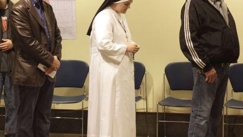 A nun waited in line to cast her vote in Janesville, Wisconsin.
