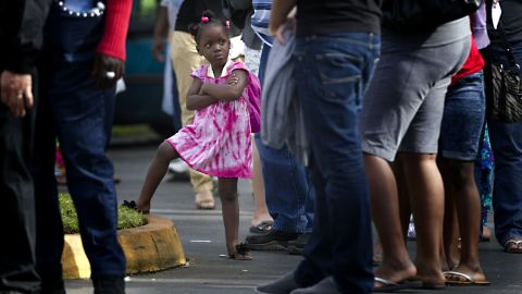 Kezia Gipson, 3, waits with her grandparents Doris Ross and Freddie Irvin in a voting line at the International Longshoremen's Association Office in Ft. Lauderdale, Florida, on Tuesday.