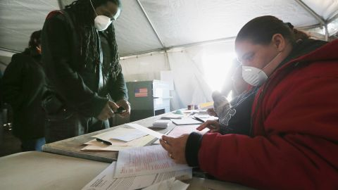 Jesse James, whose home was damaged by Superstorm Sandy, prepared to vote in a makeshift tent set up as a polling place in Rockaway Park, a neighborhood in Queens, New York.