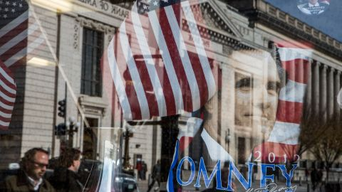A street scene was reflected in the window of a gift shop near the White House in Washington, DC.
