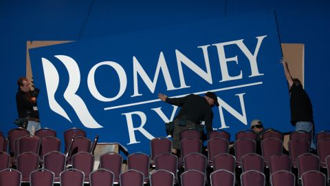 Workers put up signs Monday for Romney's election night event in Boston.