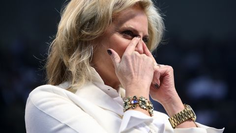Ann Romney wipes away tears during her husband's campaign rally Monday in Manchester.