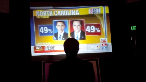 """Big boards in Tampa reported results at an event sponsored by the Republican Party of Florida. <a href=""""http://www.cnn.com/2012/09/26/politics/gallery/campaign-trail/index.html"""" target=""""_blank"""">See the best of Romney and Obama on the campaign trail. </a>"""