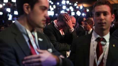 A Romney supporter's bowed head and slumped shoulders revealed that it wasn't going to be the Republicans' night.