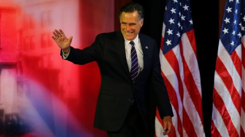 Mitt Romney waved to a crowd of supporters before conceding the presidency.