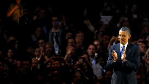 President Barack Obama clapped onstage in Chicago as the crowd cheered his reelection.