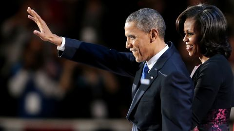 With first lady Michell Obama at his side, President Barack Obama gave the crowd a wave at an election night celebration in Chicago.