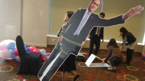 A South Korean woman carried a cardboard cutout of Republican Mitt Romney at an election night party in Seoul. South Koreans watched the race closely.
