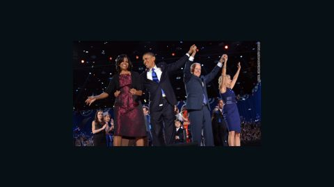 (From L-R) First Lady Michelle, US President Barack Obama, Vice-President Joe Biden and Second Lady Jill Biden acknowledge supporters following Obama's victory speech in Chicago on November 7, 2012. Obama swept to re-election, forging history again by transcending a slow economic recovery and the high unemployment which haunted his first term to beat Republican Mitt Romney. AFP PHOTO/Jewel SAMAD        (Photo credit should read JEWEL SAMAD/AFP/Getty Images)