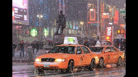 "Cabs and pedestrians navigate the snow from a nor'easter falling in Manhattan on Wednesdayin this photo taken by<a href=""http://ireport.cnn.com/docs/DOC-877979"" target=""_blank""> CNN iReporter Edgar Alan Zeta Yap</a>."