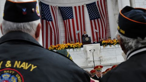 Veterans watch as President Barack Obama speaks at the Memorial Amphitheater after taking part in a wreath-laying ceremony on Veterans Day on November 11, 2011 at Arlington National Cemetery in Arlington, Virginia.