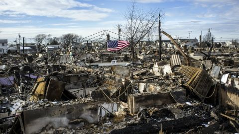 The remains of over a hundred homes lay a burnt out husk in Rockaway, NY on Thursday.