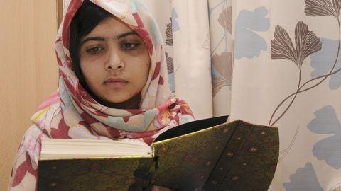 Malala Yousufzai, 15, reads a book on November 7, 2012 at the hospital.