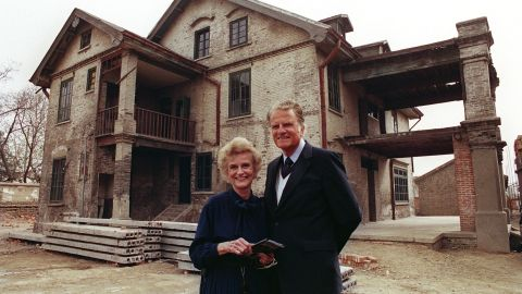 Graham and his wife visit her birthplace in Huaiyin, China, in 1988. They were married for 64 years until her death in 2007.
