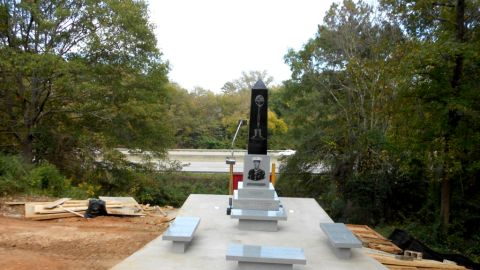 """This monument will replace the wooden sign overlooking I-75.  Visitors will be able to sit on four benches, reflecting on Davis' bravery and the text written on the lighted black and gray granite monument. The obelisk features a likeness of Davis and an etching of a helmet, rifle and boots forming a cross. One panel reads: """"May this monument be a beacon of love that shines on all those who contribute to the many efforts needed to completely restore Linwood Cemetery."""""""