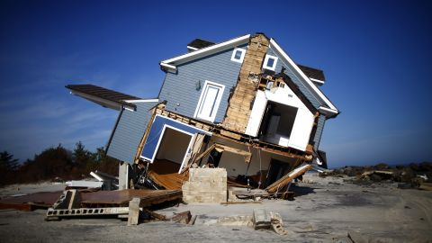 A home damaged by Sandy lists in Mantoloking, New Jersey, on Monday.