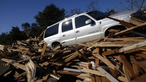 An SUV sits atop the debris from a home in Mantoloking, New Jersey, on Monday.