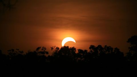 """<a href=""""http://ireport.cnn.com/people/Stitchum"""">Sandra Otto</a> took this photo from the side of the road in the northern suburbs of Darwin, Australia, after forgetting about the eclipse until it was about to happen. """"I quickly got my camera and my bigger lens and jumped into my utility,"""" she says. """" I wish I was better prepared but found it to be a truly amazing experience, spectacular."""""""