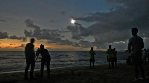 """iReporter <a href=""""http://ireport.cnn.com/docs/DOC-881111"""">David Brungger</a> was one of many people to witness the eclipse at Palm Cove in the north of Queensland. """"When everything finally went almost totally dark, some people were clapping, some people were cheering with joy, and we all took our eclipse glasses off to enjoy some of the most exciting and beautiful seconds of my life. Too bad it only lasted roughly one minute,"""" he says."""