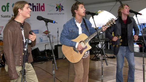 """Isaac, Taylor and Zac Hanson of Hanson perform in 2001. The brothers became superstars with their 1997 album """"Middle of Nowhere"""" thanks to a little earworm called """"MMMBop."""""""