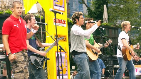"""Erik-Michael Estrada, Jacob Underwood, Trevor Penick, Dan Miller and Ashley Parker Angel of the group O-Town perform in 2002. The group, which came to be thanks to the first season of MTV's """"Making the Band,"""" is perhaps best known for the single """"Liquid Dreams"""" in 2000."""