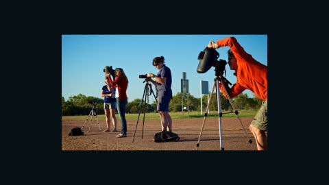 """<a href=""""http://www.flickr.com/photos/8547591@N08/"""" target=""""_blank"""" target=""""_blank"""">David Freeman</a> of Longreach in outback Queensland sent in this image of photographers prepping for the big moment. """"Even if we didn't get totality the light was really interesting,"""" he says. """"Coming so close after sunrise we had the typical outback orange and red sunrise and then went into an almost surreal subdued light. Not the same colors as a normal sunrise but definitely not normal daylight either."""""""