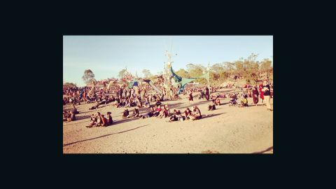 """Tomoya Arai of Japan took this image of crowds at the Eclipse2012 festival in the north Queensland outback. As the eclipse began Arai, said he was reminded of Albert Einstein's words: """"The most beautiful experience we can have is the mysterious."""""""
