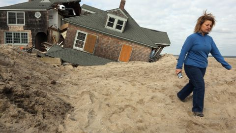 Lisa Baney walks back toward her family's home in Bay Head, New Jersey, after taking a photo of a neighbor's destroyed house Wednesday, November 14.