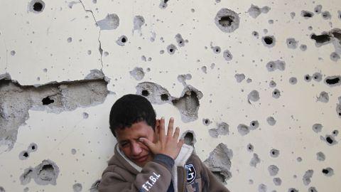 Palestinian Fares Sadallah, 11, cries outside his home after an Israeli airstrike Friday, November 16, in northern Gaza.