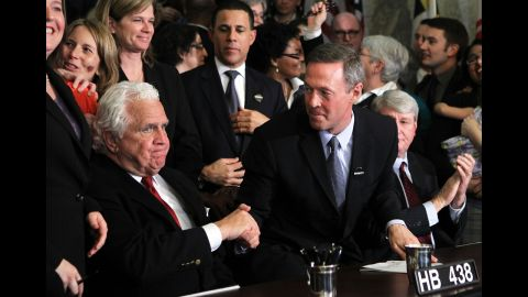 """On March 1, 2012, Maryland Gov. Martin O'Malley, center, shakes hands with Senate President Thomas V. """"Mike"""" Miller after signing a same-sex marriage bill. The law was challenged, but voters approved marriage equality in a November 2012 referendum."""