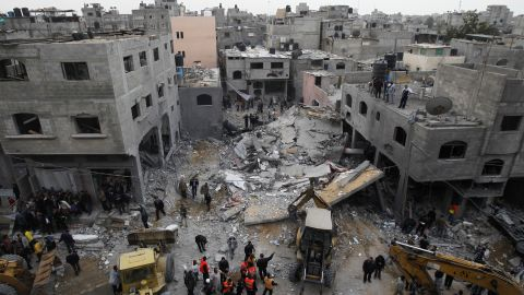Palestinians gather at the site of an Israeli air raid in Gaza City on November 17, 2012. Israeli air strikes hit the cabinet headquarters of Gaza's Hamas government after militants fired rockets at Jerusalem and Tel Aviv as Israel called up thousands more reservists in readiness for a potential ground war.